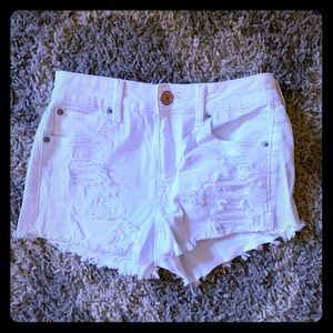 American Eagle distressed white shorts
